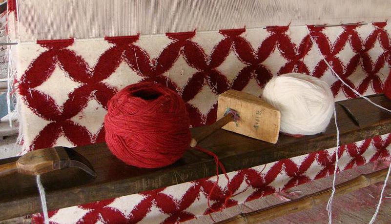 04- Weaving on loom